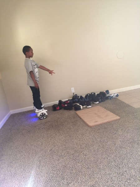 This is photo of my nephew and his collection of shoes. The sneaker culture sometimes connect different generations. Shoes that were popular when i was his age is still popular today