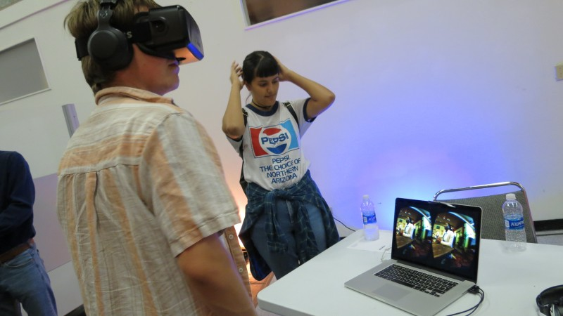 Myself, using VR for the first time. However, it is not for a game, but for a health study/awareness program. In this photo, though obviously impossible to tell, I am experiencing what it is like to have schizophrenia. To say the least, the experience was chilling, scary. It's examples like these that show the true use of VR.